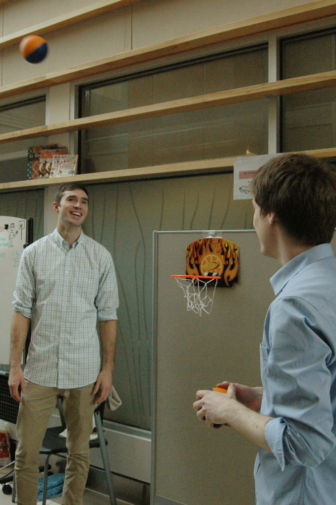 Master's student Stephane MacLean and Software Developer Jacob Kroeker use basketball to teach visitors about our research in PRISM adaptation.